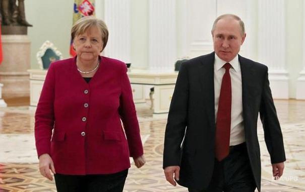 Путин и Меркель обсудили особый статус Донбасса